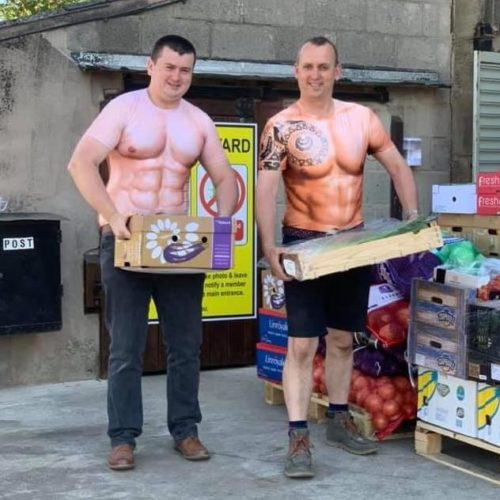 Ted Newton and Rob Copley from Farmer Copleys holding boxes of vegetables