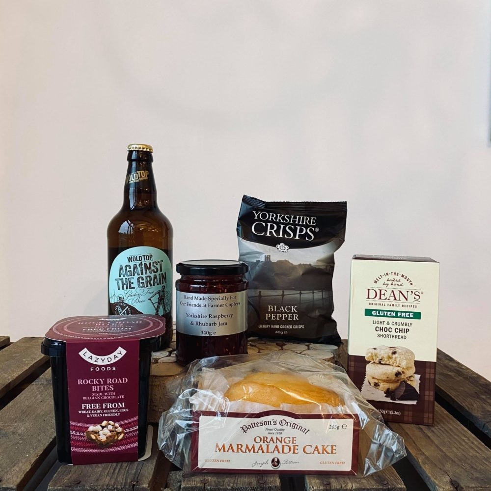 Gluten free products available from Farmer Copleys farm shop, on top of a wooden box.