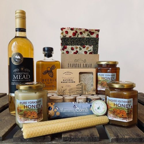 Queen bee hamper full of honey products at Farmer Copleys farm shop.